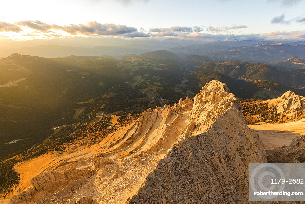 Aerial view of Latemar massif and Obereggen at sunset, Dolomites, South Tyrol, Italy