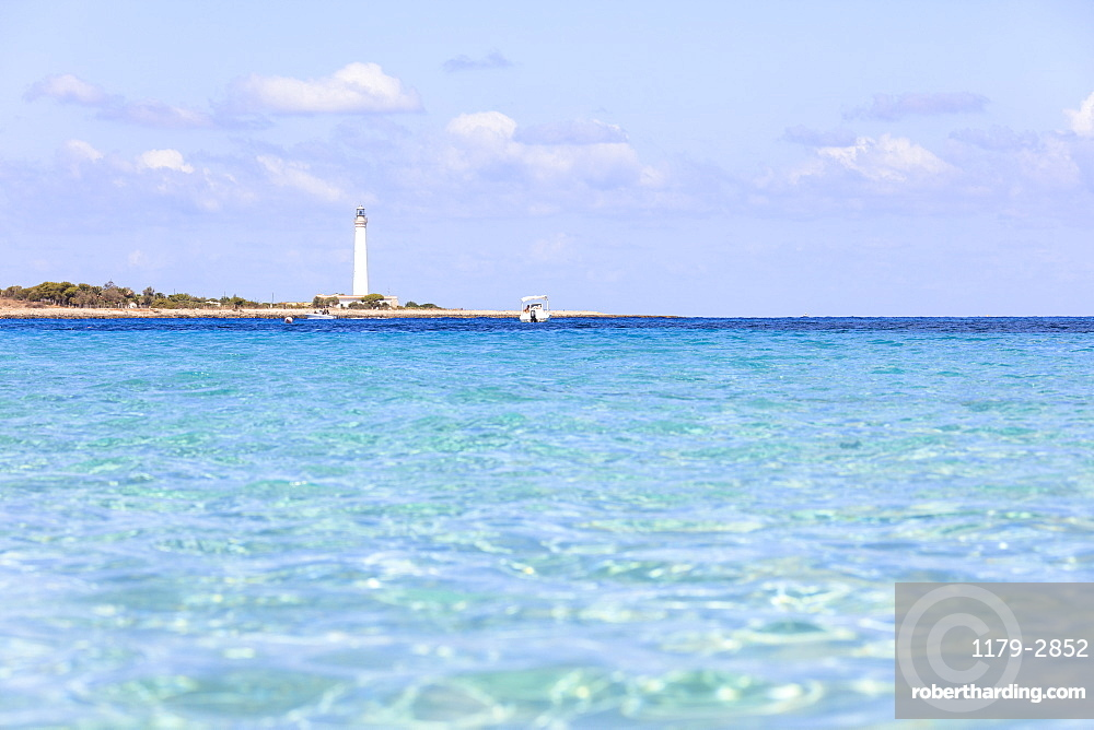 Turquoise sea with lighthouse in the background, San Vito Lo Capo, province of Trapani, Sicily, Italy, Mediterranean, Europe