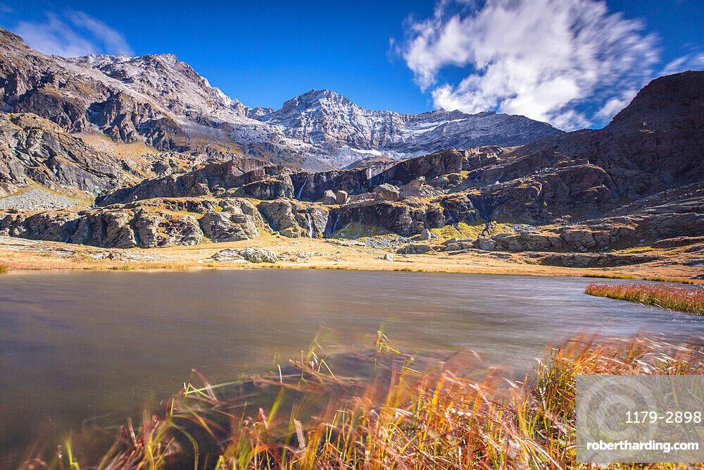 Alpine lake during autumn, Alpe Fora, Malenco Valley, province of Sondrio, Valtellina, Lombardy, Italy