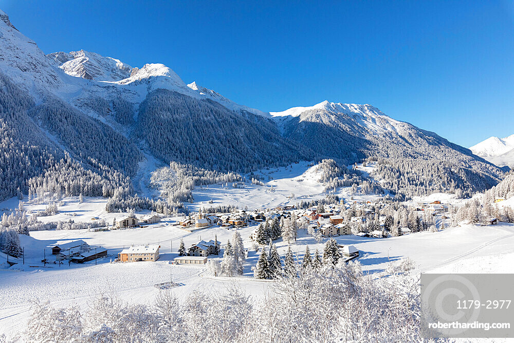 Alpine village of Bergun covered with snow, Albula Valley, Canton of Graubunden, Switzerland, Europe
