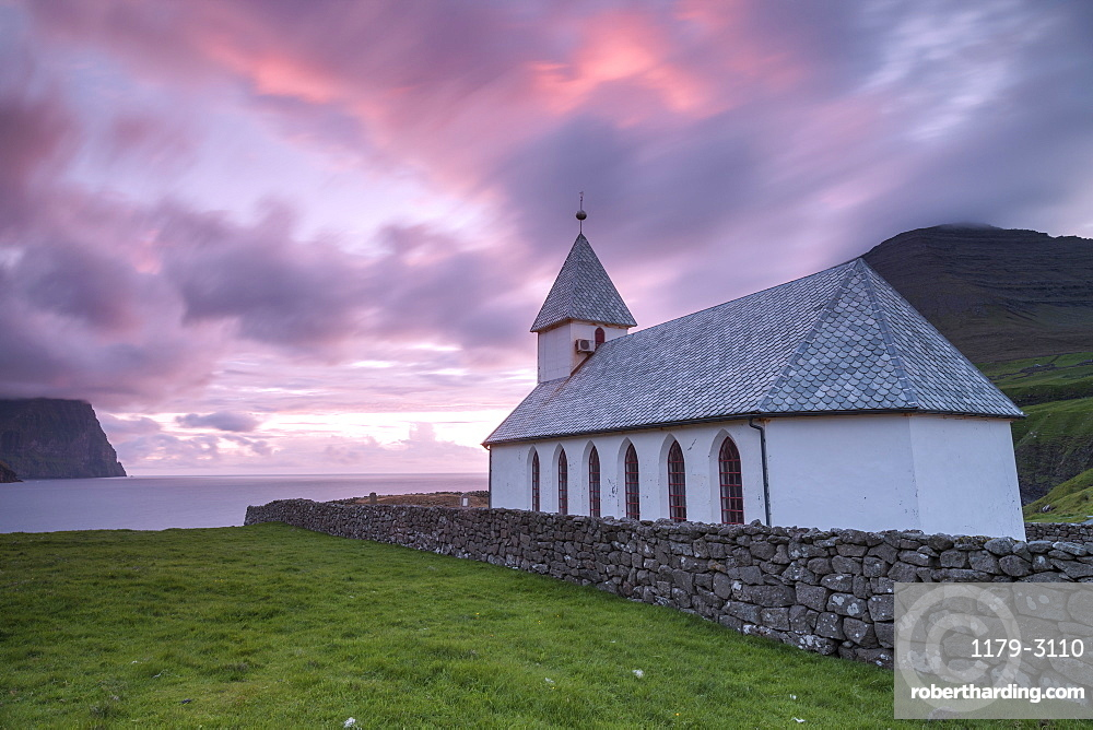 Sunrise on church of Vidareidi, Vidoy Island, Faroe Islands, Denmark, Europe