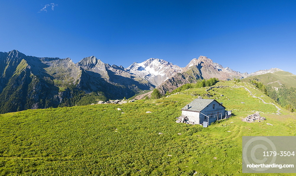 Panoramic aerial view of hut on green meadows, Scermendone Alp, Sondrio province, Valtellina, Rhaetian Alps, Lombardy, Italy, Europe