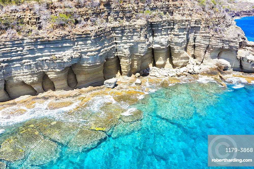 White limestone cliffs Pillar of Hercules washed by Caribbean Sea, aerial view, English Harbour, Antigua, West Indies (drone)