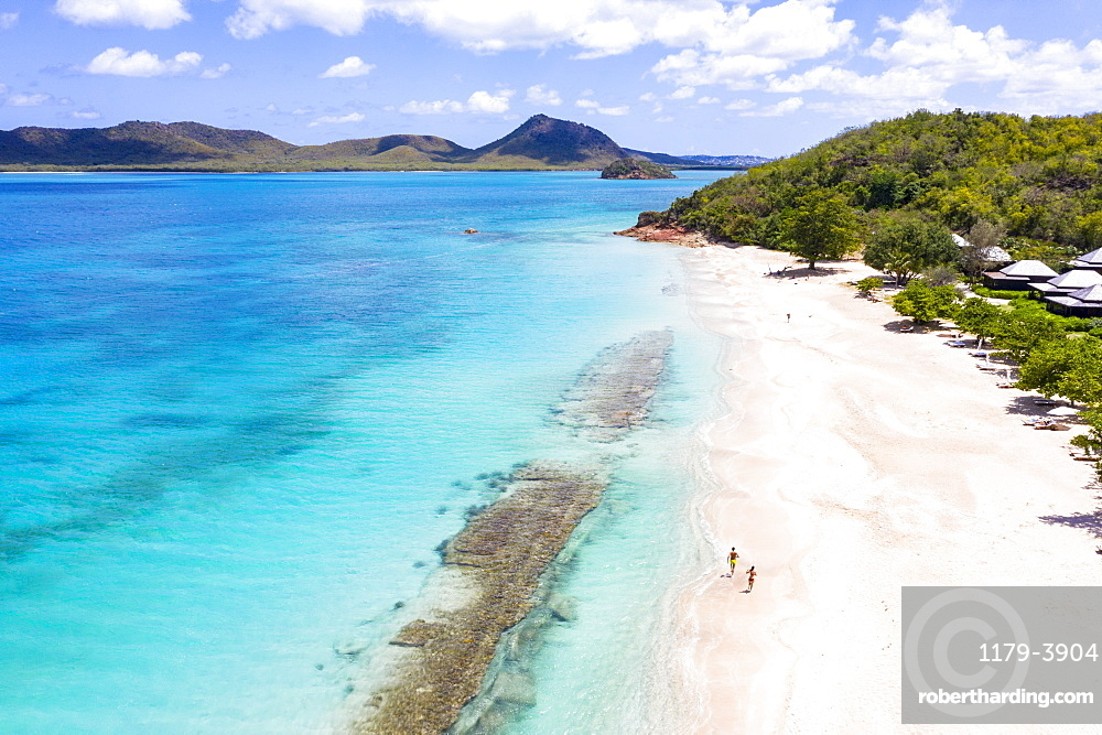 Aerial view by drone of man and woman running on white sand beach, Antilles, West Indies, Caribbean, Central America