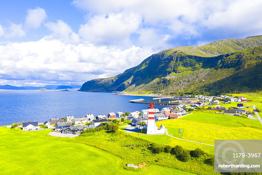 Aerial view of Alnes Lighthouse and village, Godoya Island, Alesund, More og Romsdal County, Norway (drone)
