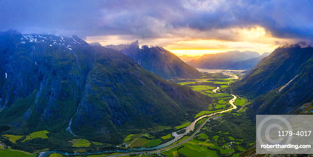 Aerial view of clouds at sunset over Romsdalen valley from Romsdalseggen ridge, Andalsnes, More og Romsdal county, Norway (drone)
