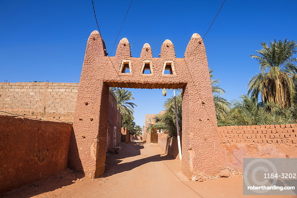 Red town gate in Timimoun, western Algeria, North Africa, Africa