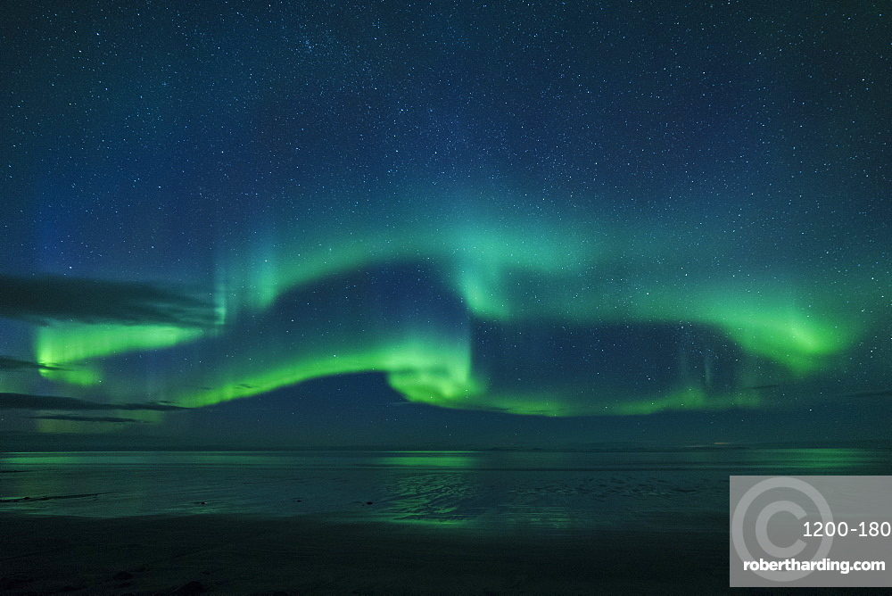 Aurora borealis reflecrted in ocean, North Snaefellsnes, Iceland.