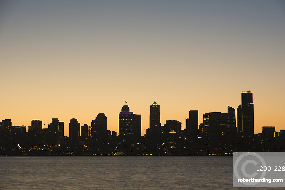 Seattle skyline at dawn, as seen from Alki Beach, Washington, United States.