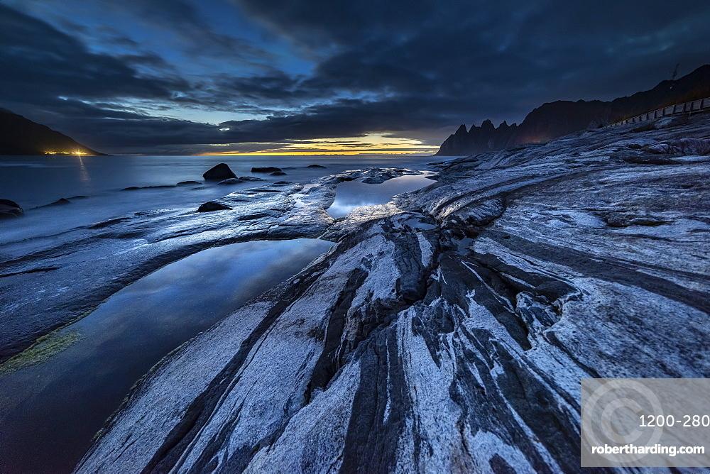Rock formations and reflection, at dusk, Tungeneset, Senja, Norway, Scandinavia, Europe