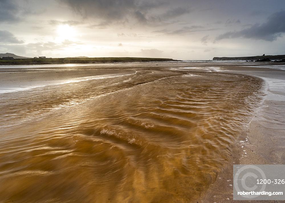 Strong winds across Ferriter's Cove beach, Dingle Peninsula, Kerry, Republic of Ireland.