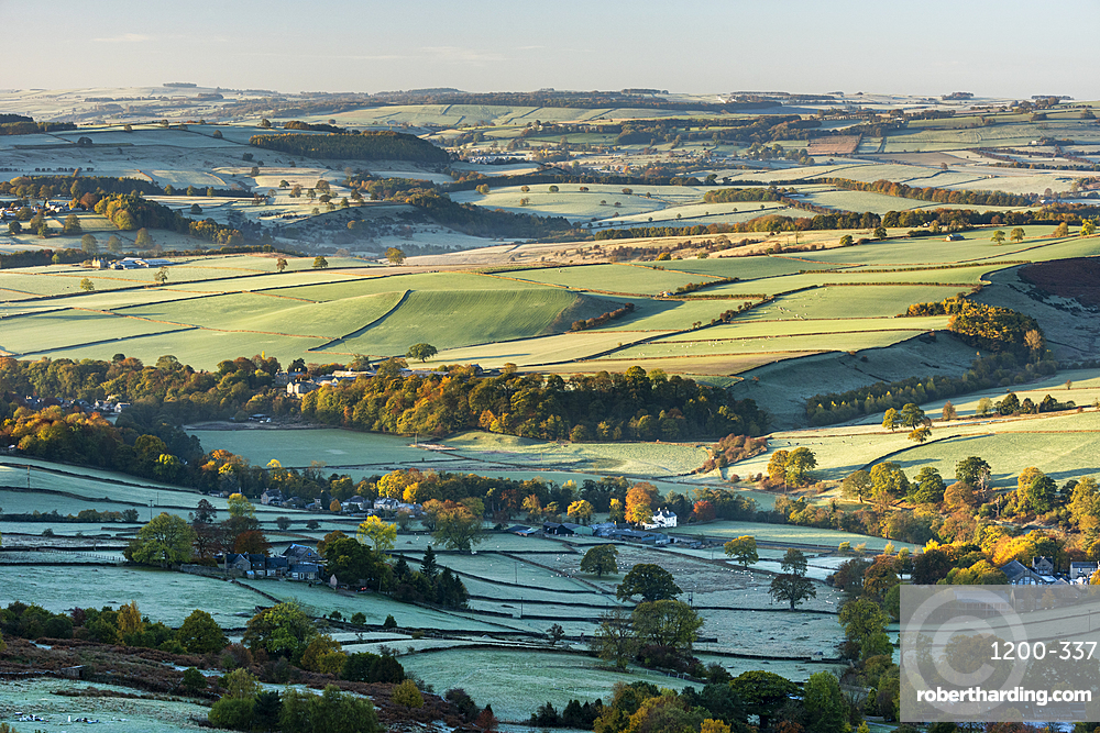 View from Curbar Edge at sunrise, looking south towards Baslow and Chatsworth, Peak District National Park, Derbyshire, autumn