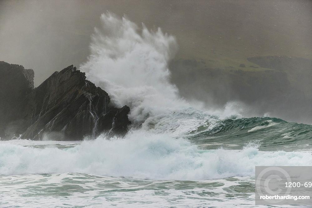 Waves crashing on rocks, Clogher Bay, Clogher, Dingle Peninsula, County Kerry, Ireland, British Isles
