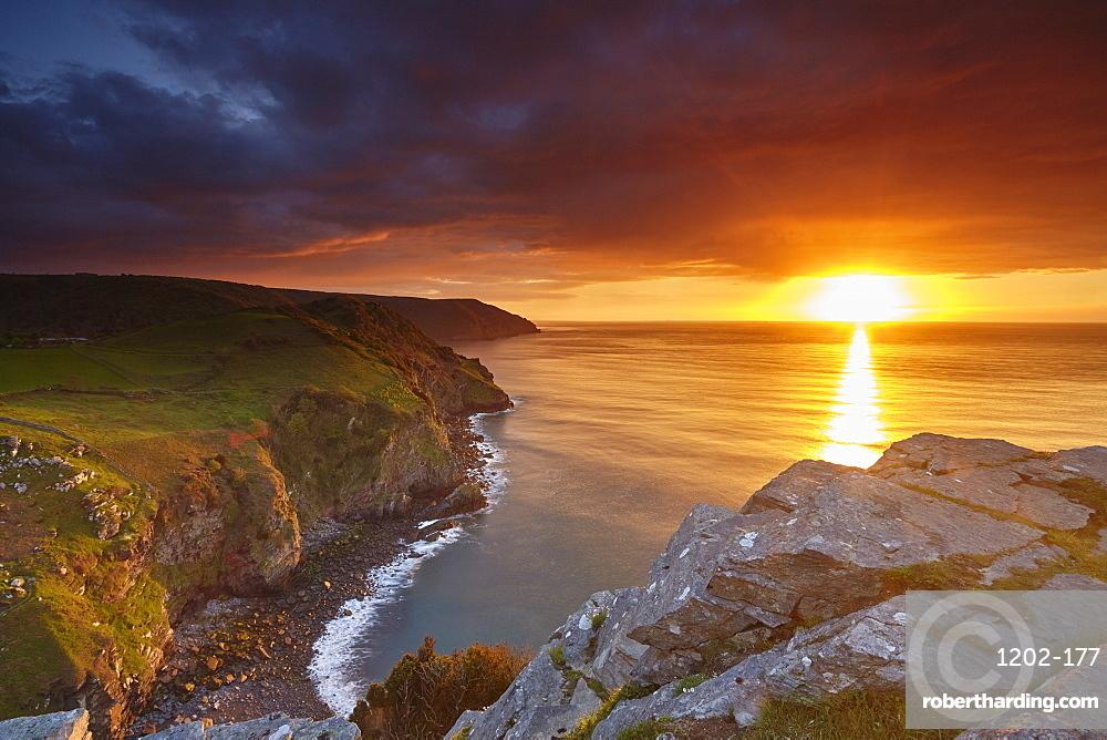 Sunset over coastal cliffs seen from the Valley of Rocks, Lynton, Exmoor National Park, Devon, England, United Kingdom, Europe