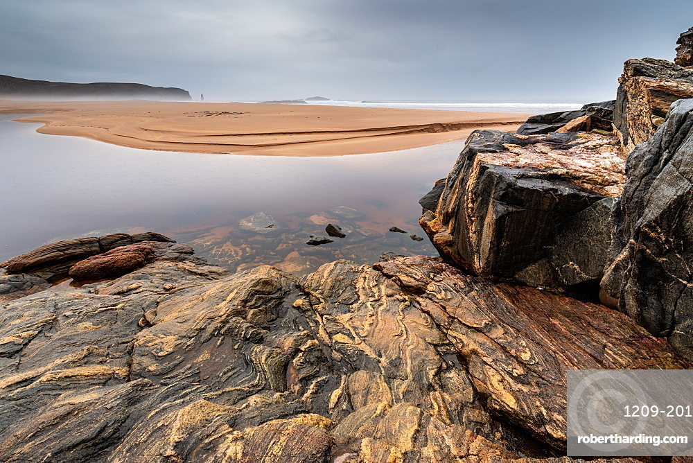 Rock formations at Sandwood Bay, Sutherland, Scotland, UK. Am Buachaille sea stack far distance.