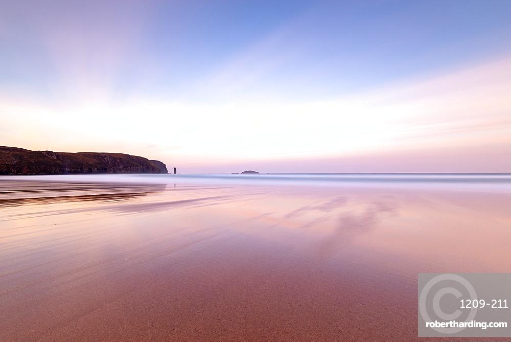 Sandwood Bay, Sutherland, Scotland, UK. Sunrise. Am Buachaille sea stack far distance.