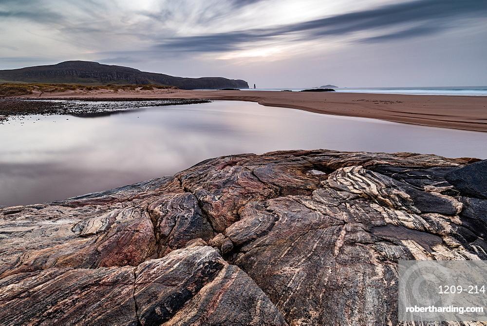 Sandwood Bay, Sutherland, Scotland, UK. Am Buachaille sea stack far distance. Heading towards sunset.