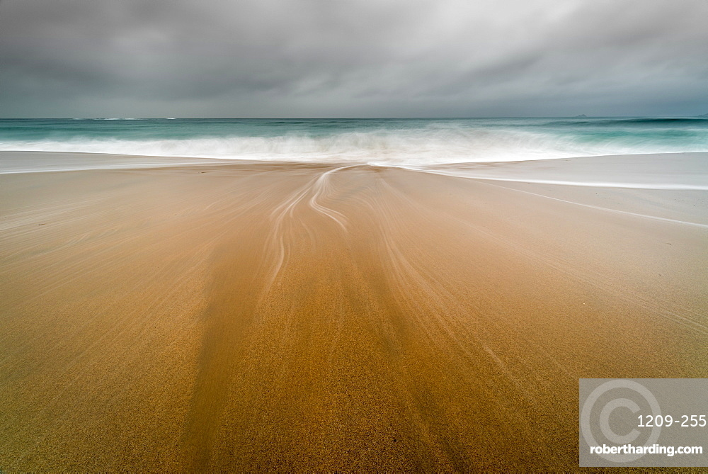 Water trails on Sennen Beach, with Brissons in far distance, Sennen, Cornwall, England, United Kingdom, Europe