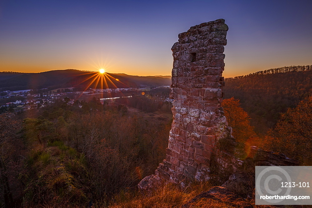 Sunset over the Chateau de Ramstein, a ruined castle in the commune of Baerenthal, in the Moselle region of France, Europe.