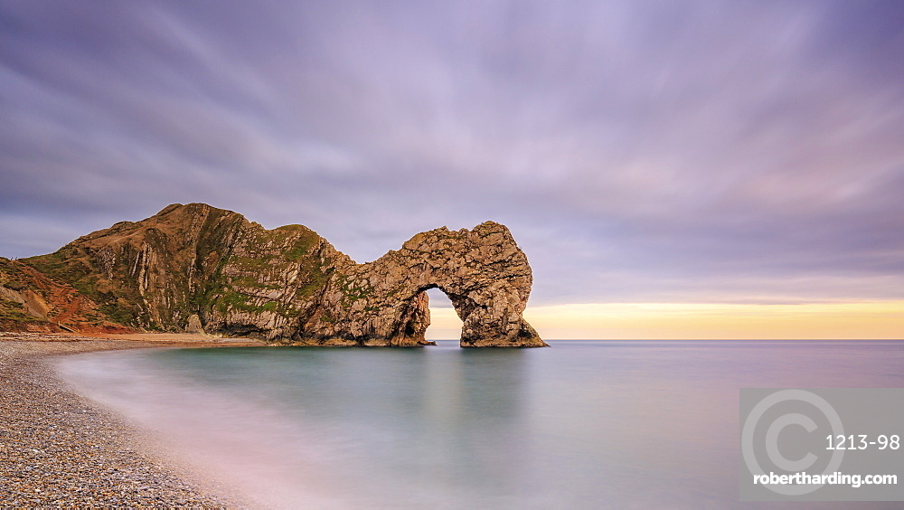 Dusk descends at Durdle Door on the Jurassic Coast, UNESCO World Heritage Site, Dorset, England, United Kingdom, Europe