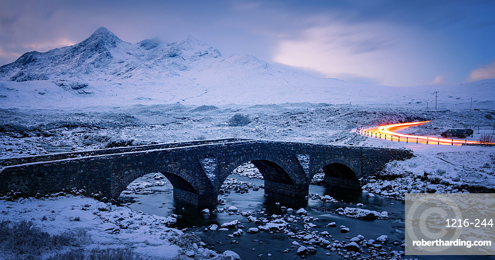 Sligachan Bridge in the snow with car light trails, Isle of Skye, Inner Hebrides, Scotland, United Kingdom, Europe