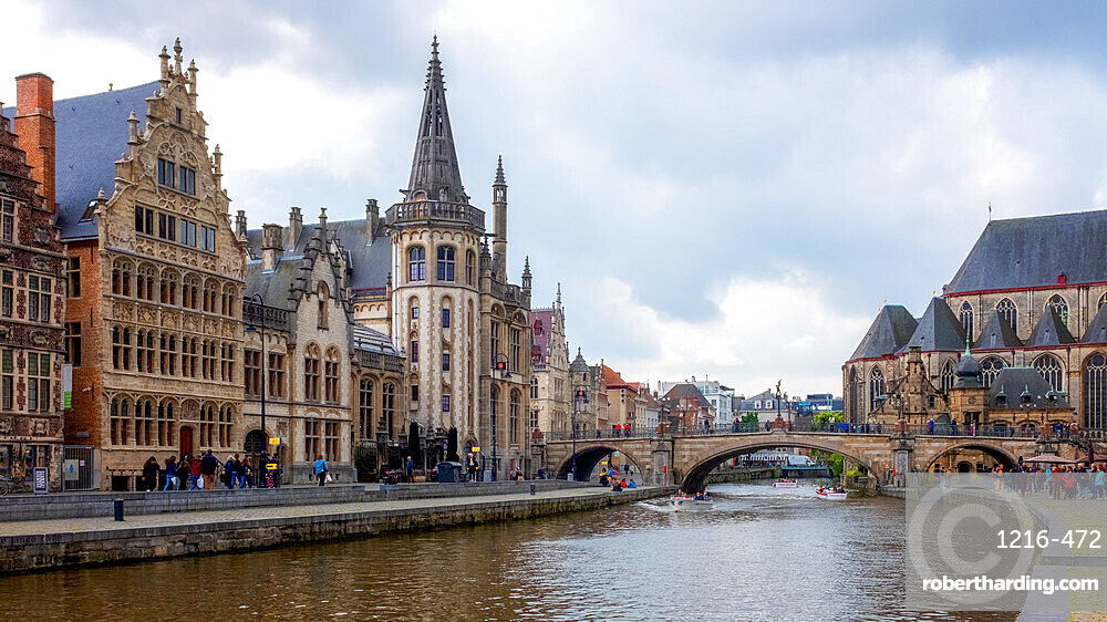 Graslei, Ghent, Belgium, Europe. Locals and visitors relax along the Leie canal, famous for its beautiful historic facades.
