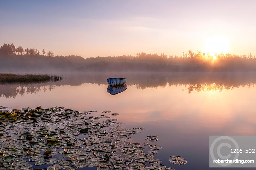 Lone boat at sunrise, Loch Rusky, Highlands, Scotland, United Kingdom, Europe