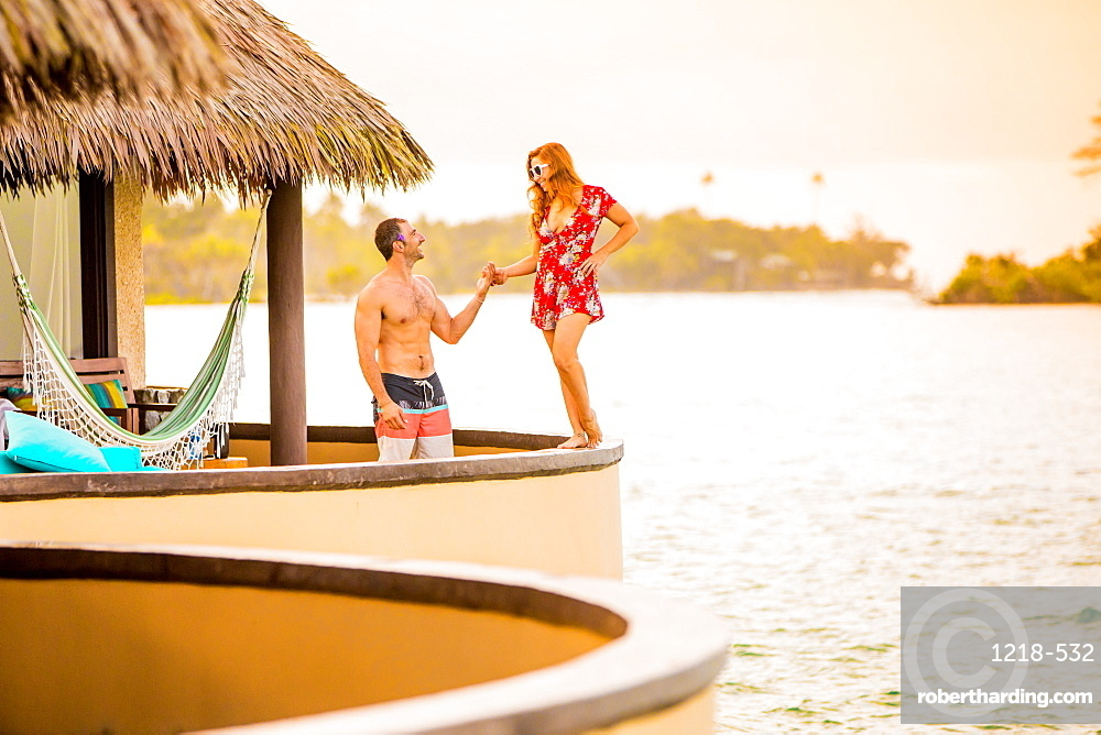 Couple in front of their Bure at Koro Sun Resort, Fiji, South Pacific, Pacific