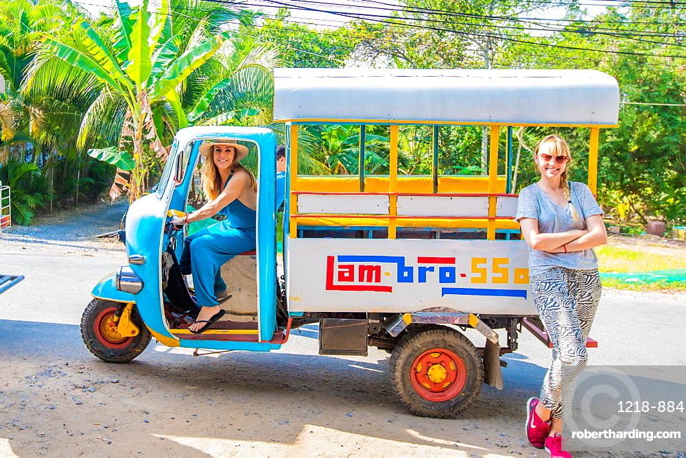 American women tourists on bemo in Vietnam.