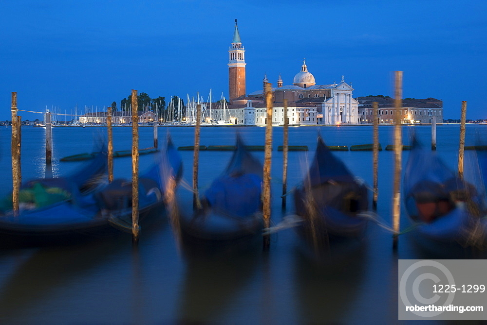 Gondolas near San Marco moored to wooden posts at twilight with San Giorgio in the distance, Venice, UNESCO World Heritage Site, Veneto, Italy, Europe