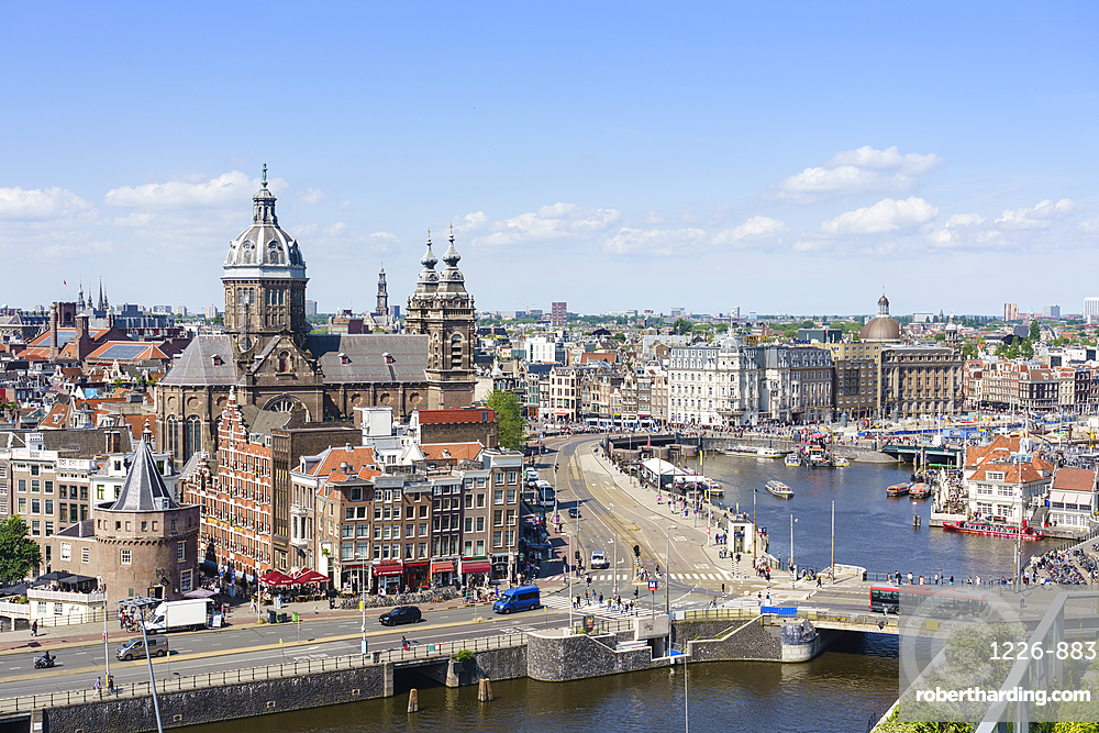 High angle view of central Amsterdam with St Nicholas Church and tower, Netherlands