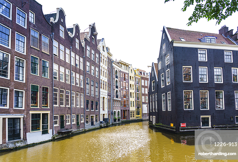 Old gabled buildings by a canal, Oudezijds Kolk, Amsterdam, Netherlands