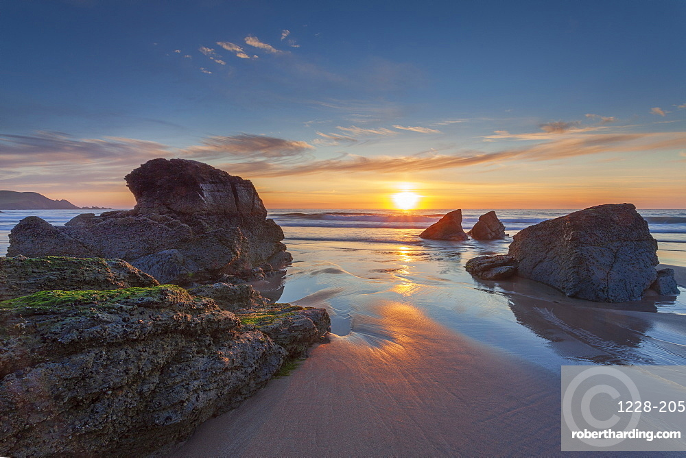 Sun setting over Sango Bay beach in mid-summer, Durness, Scotland.