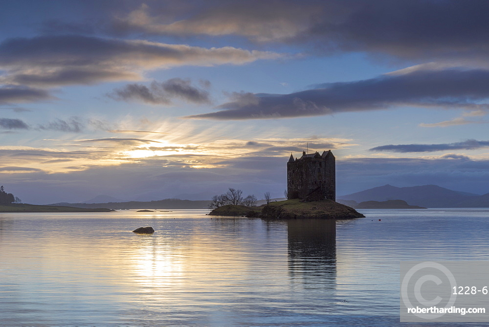Mid-winter sunset over Loch Linnhe and Castle Stalker in winter, Argyll and Bute, Scotland, United Kingdom, Europe