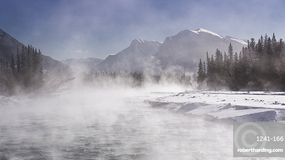 Mist rising off the waters of the Bow River in sub-zero winter weather, Canmore, Alberta, Canadian Rockies, Canada, North America
