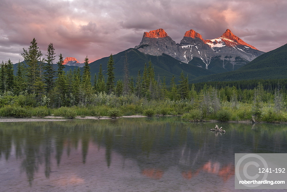 Sunset and Alpenglow on the peaks of Three Sisters, Canmore, Alberta, Canadian Rockies, Canada, North America