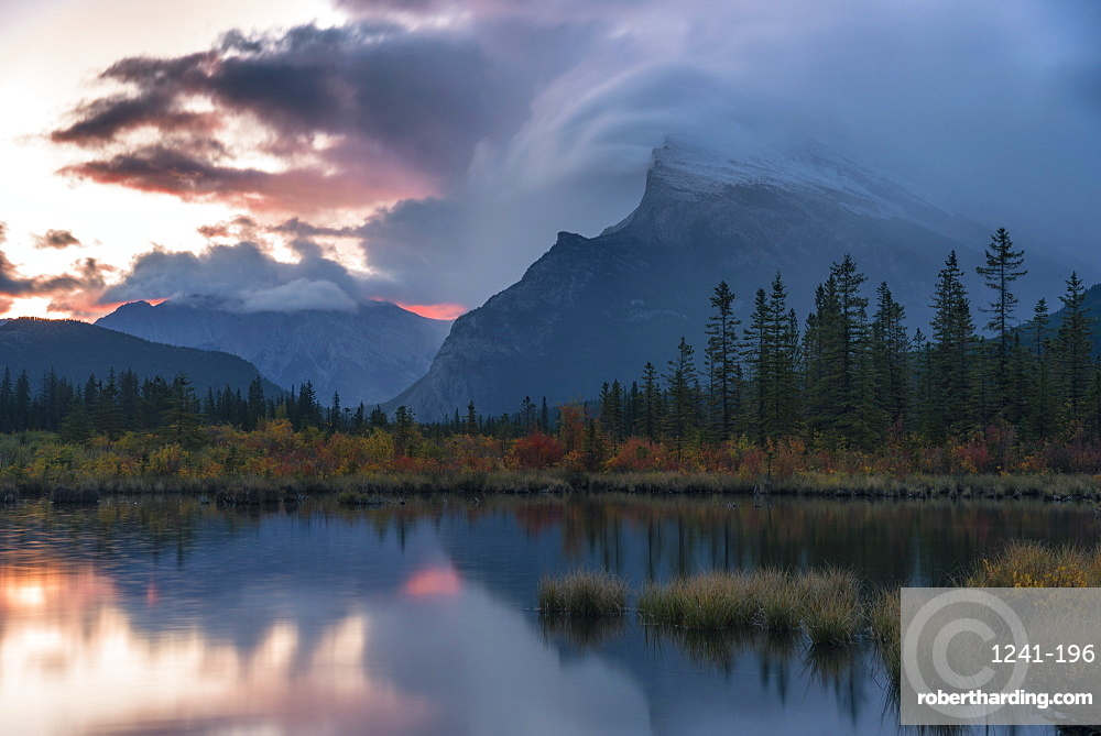 Sunrise and storm clouds at Vermillion Lakes with Mount Rundle in Autumn, Banff National Park, Alberta, Canada