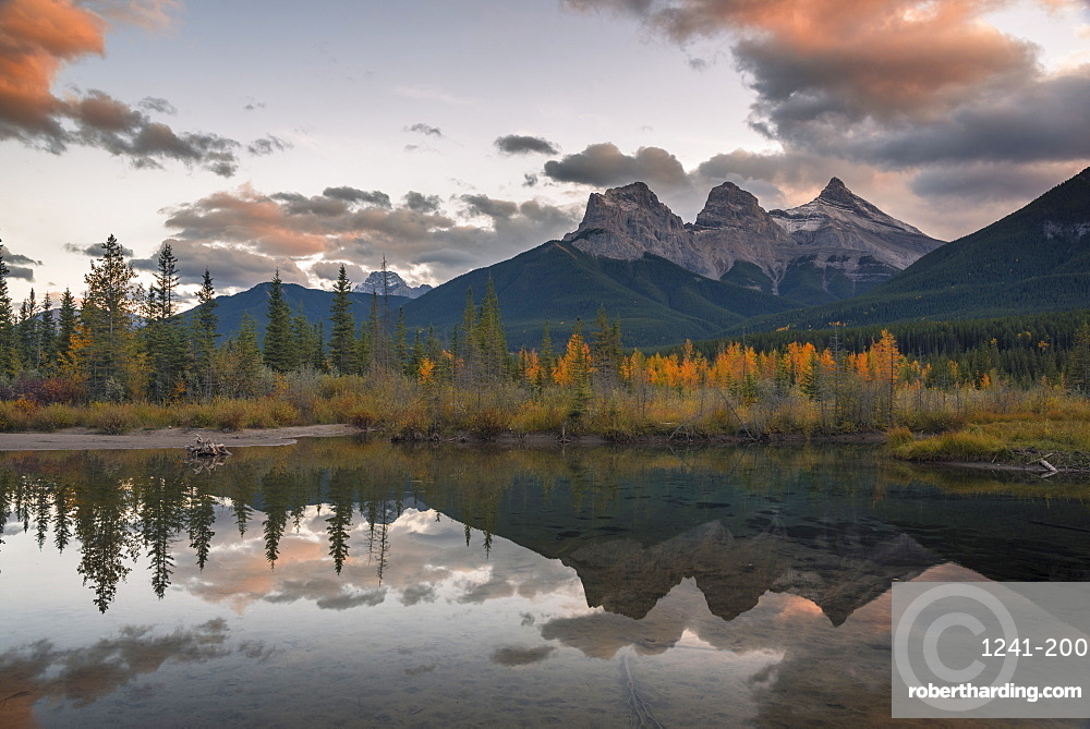 Sunset over Three Sisters in Autumn near Banff National Park, Canmore, Alberta, Canada