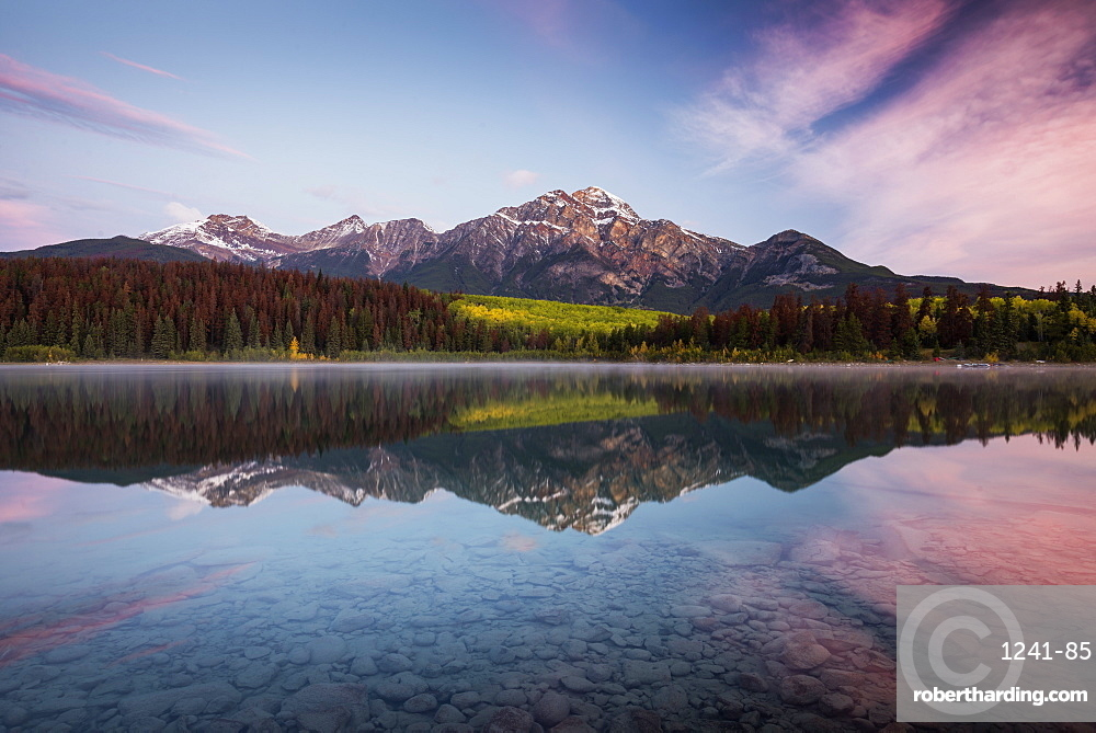 Pyramid Mountain reflected in Patricia Lake in autumn at sunrise, Jasper National Park, UNESCO World Heritage Site, Canadian Rockies, Alberta, Canada, North America