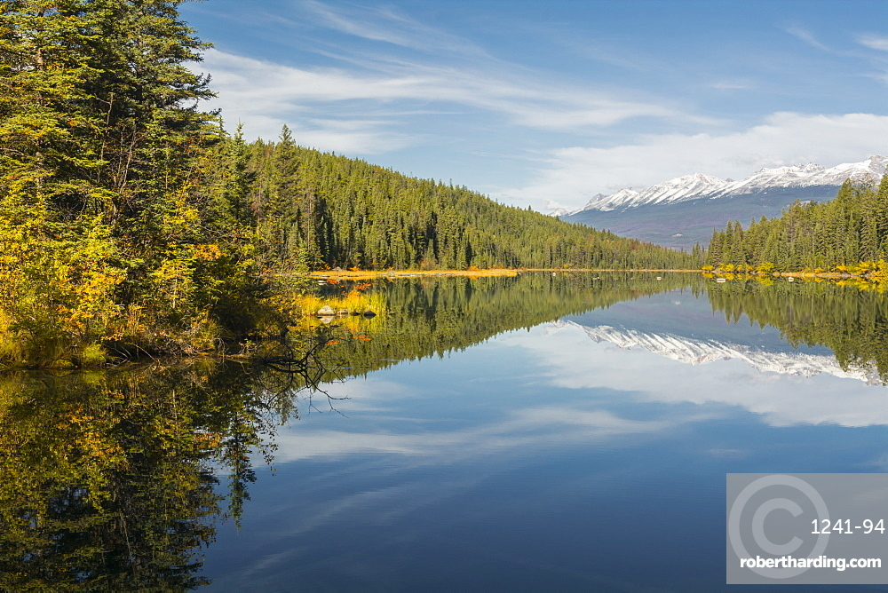 Mountains reflected in a lake along Valley of Five Lakes trail, Jasper National Park, Canada. nature, landscape, great outdoors