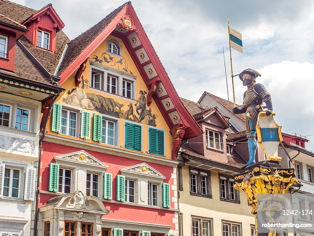 Colourful historic buildings and statue, Zug, Switzerland, Europe