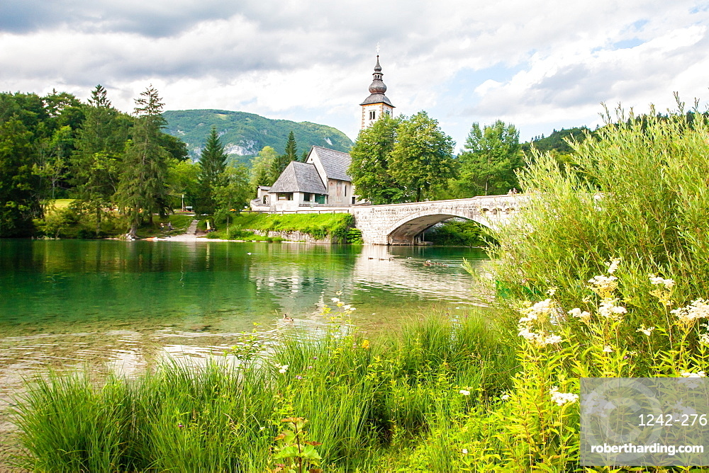 The bridge and church in the lakeside village of Ribcev Laz, Lake Bohinj, Slovenia, Europe