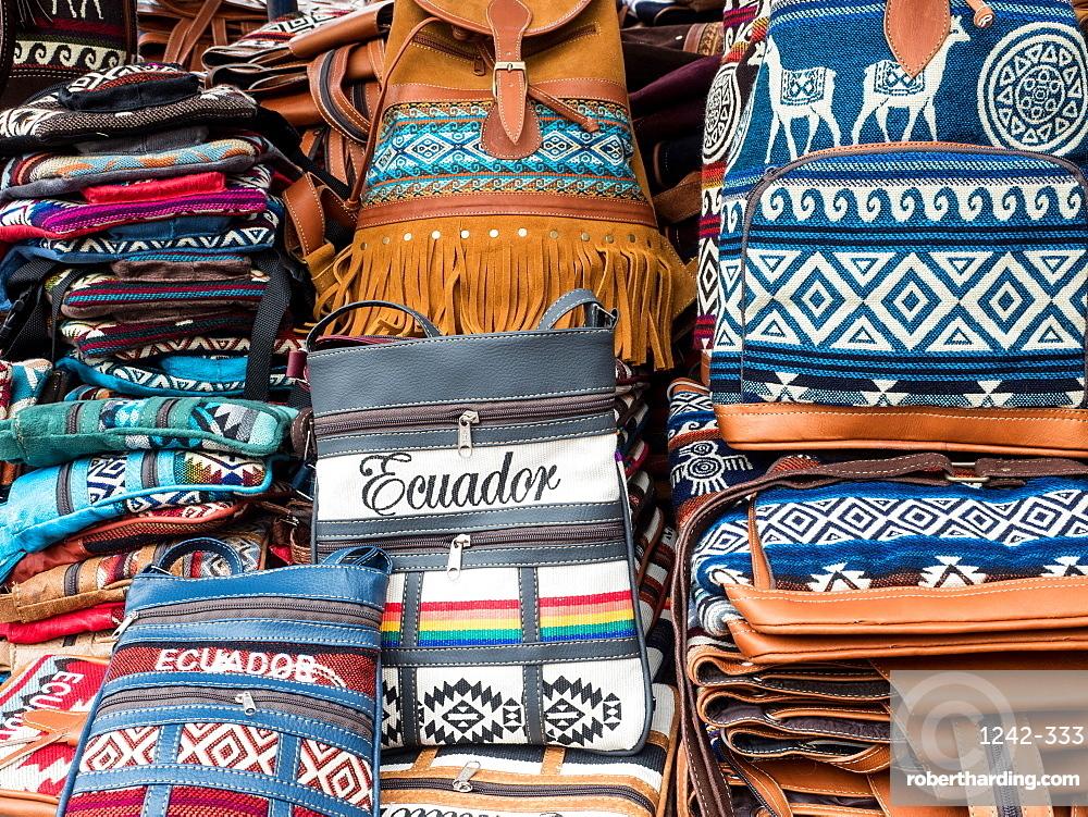 Tourist goods for sale, craft market, Plaza de los Ponchos, Otavalo, Ecuador, South America