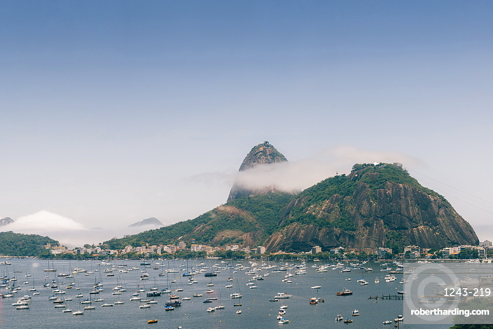Sugarloaf Mountain, known locally as Pao de Acucar, covered in fog, Rio de Janeiro, Brazil, South America