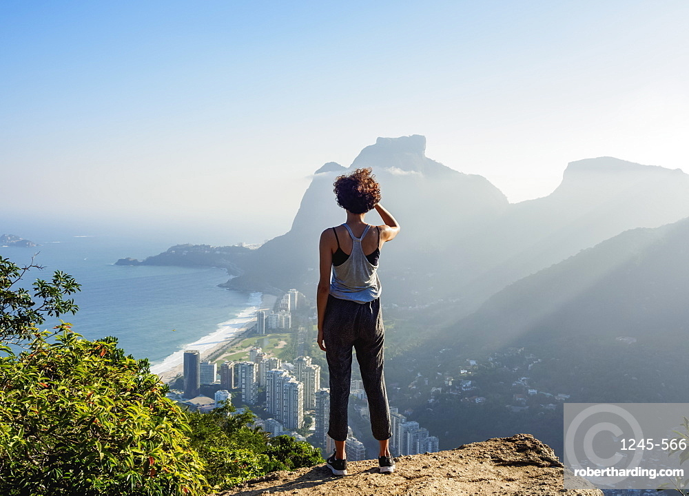 Brazilian girl looking towards the Pedra da Gavea and Sao Conrado from Dois Irmaos Mountain, Rio de Janeiro, Brazil, South America