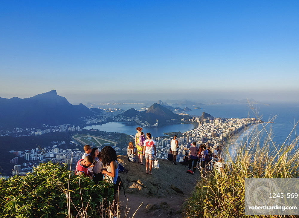 People on top of the Dois Irmaos Mountain, Rio de Janeiro, Brazil, South America