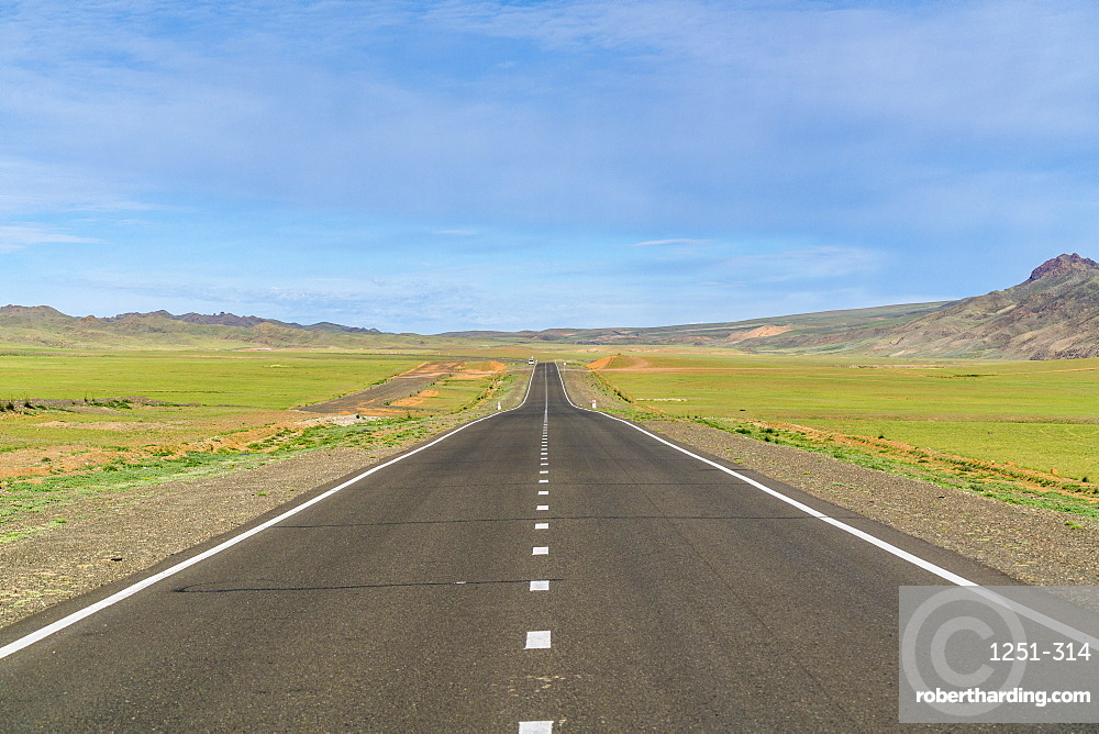 Straight paved road, Bayandalai district, South Gobi province, Mongolia, Central Asia, Asia