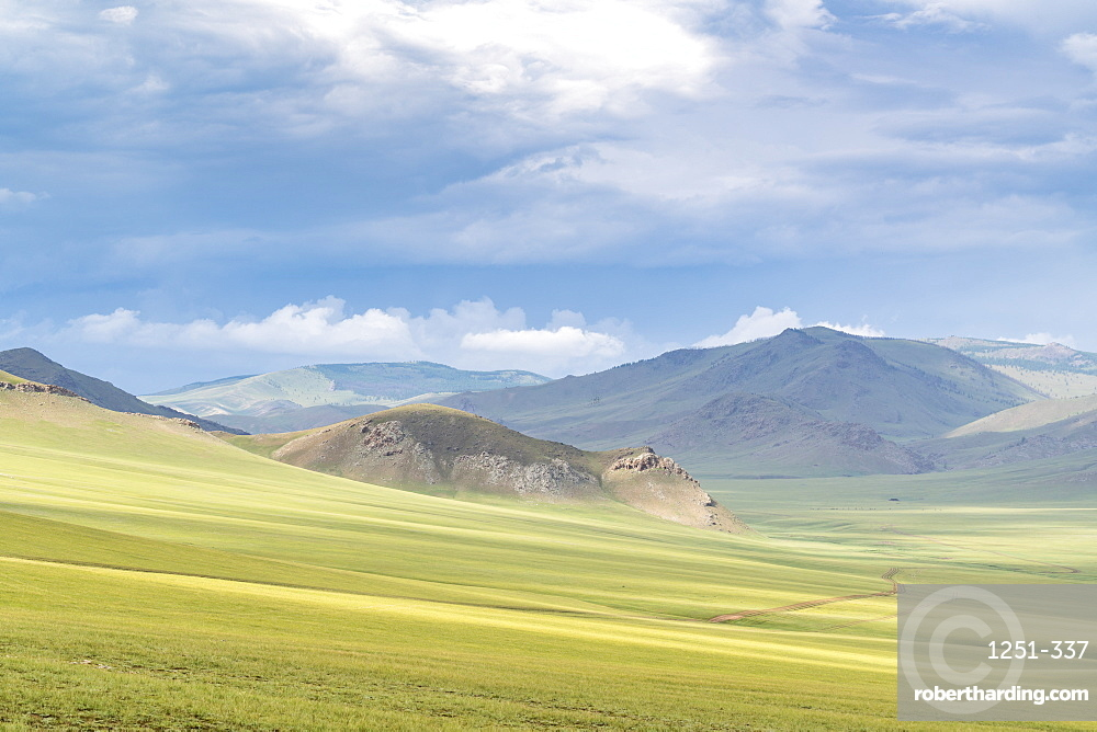 Landscape of the green Mongolian steppe under a gloomy sky, Ovorkhangai province, Mongolia, Central Asia, Asia