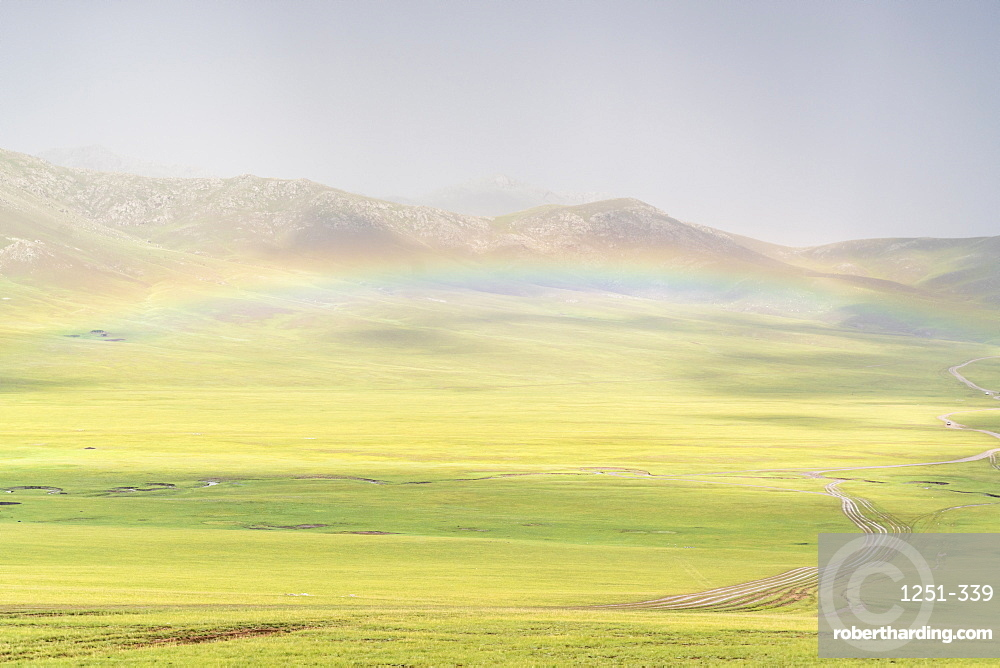 Rainbow over the green Mongolian steppe, Ovorkhangai province, Mongolia, Central Asia, Asia