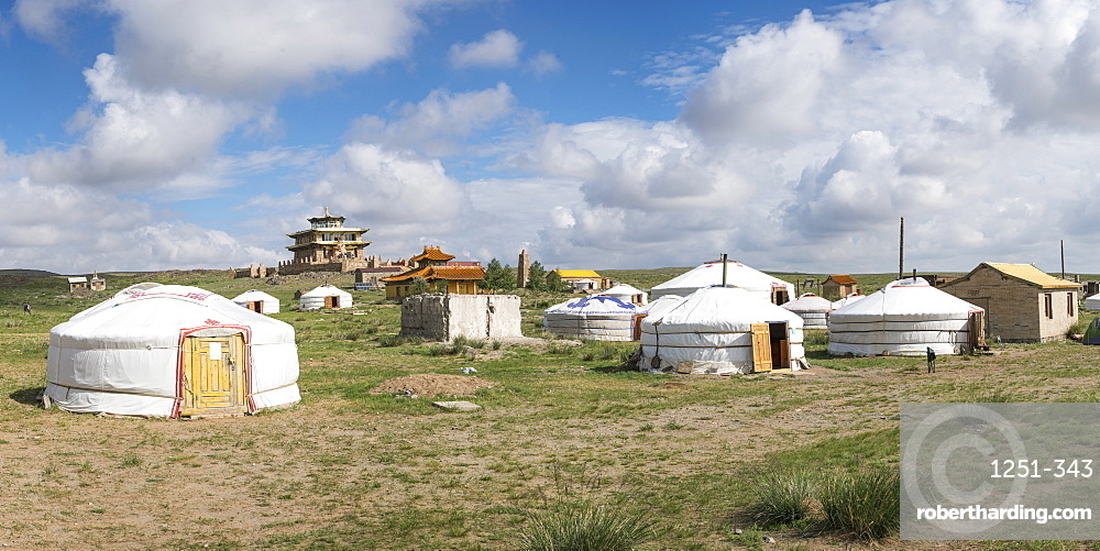 Ger camp and Tsorjiin Khureenii temple in the background. Middle Gobi province, Mongolia.